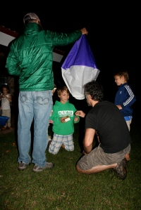 "Lighting the ""globos"" was the high light of the evening. Here, Rob holds the globo, and Sebastian helps Elliott light it."